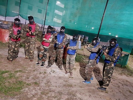 A group of friends playing Paintball