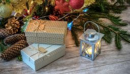 Gifts lying on the floor with a lamp