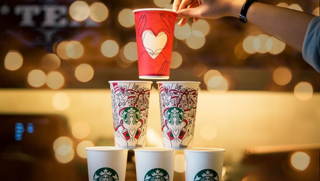 Cups of Starbucks Coffee arranged in a triangle shape