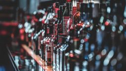 Alcohol bottles placed in a wine shop