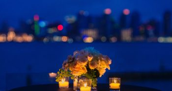 Table decorated with flowers for a candle light dinner